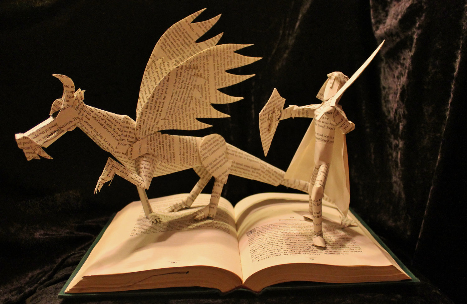 https://thebookshelfgargoyle.files.wordpress.com/2012/09/dragon-and-knight-book-sculpture.jpg