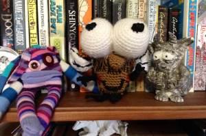 Welcoming Fly Guy to the shelf. Bruce is stunned at my crochet prowess.
